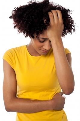 Blk woman holding head-freedigitalphotosnet-stockimages